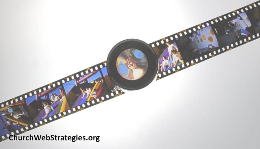 magnifying glass looking at film negatives