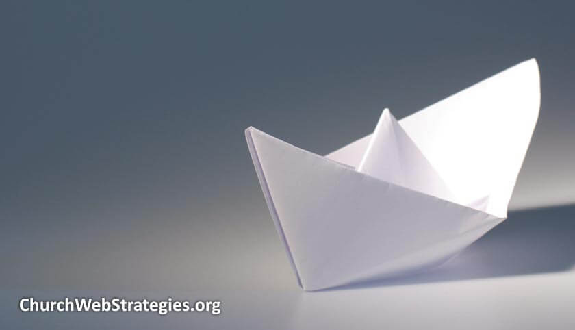 paper boat on table