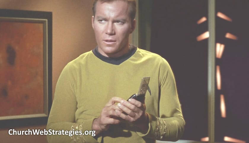 Star Trek's Captain Kirk using communicator device