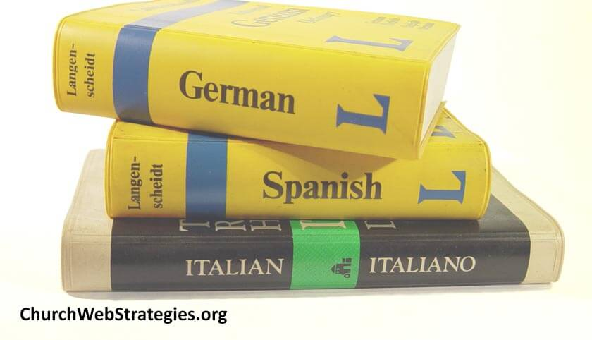 stacked German Spanish and Italian dictionaries