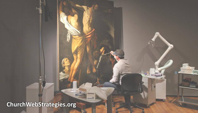 Artist restoring an old painting of Christ
