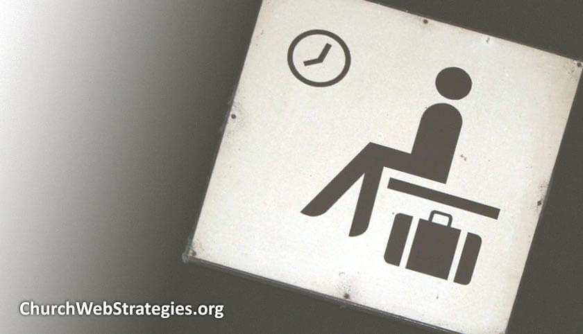sign showing person waiting on a bench with luggage